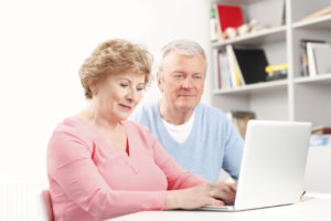 Senior couple using a laptop PC together